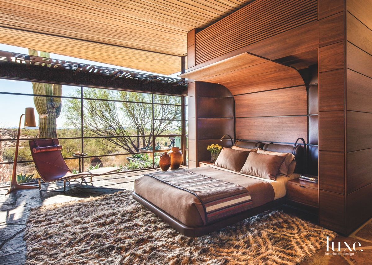 Walnut Canopy Master Bedroom with Large Windows and Rug