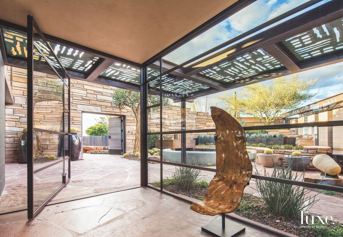 Open Glass Vestibule Entrance Courtyard with Stone and Steel