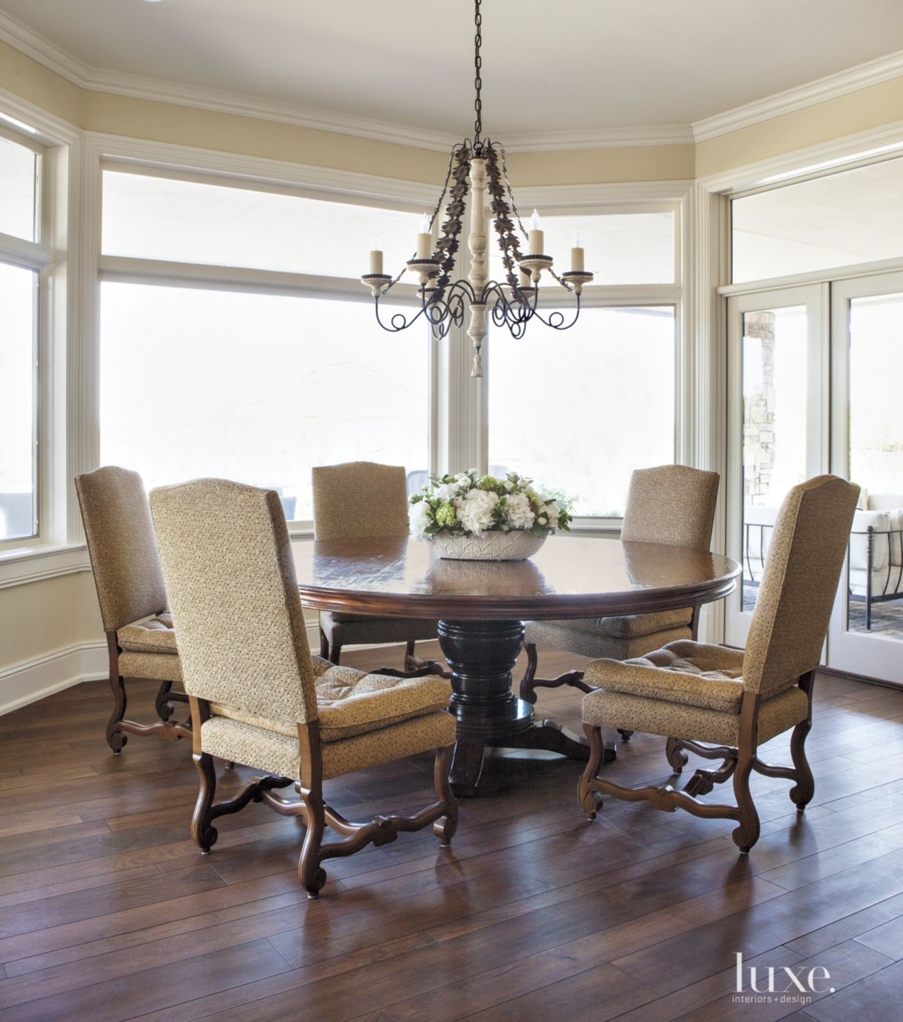 Traditional White Dining Room with Bay Window