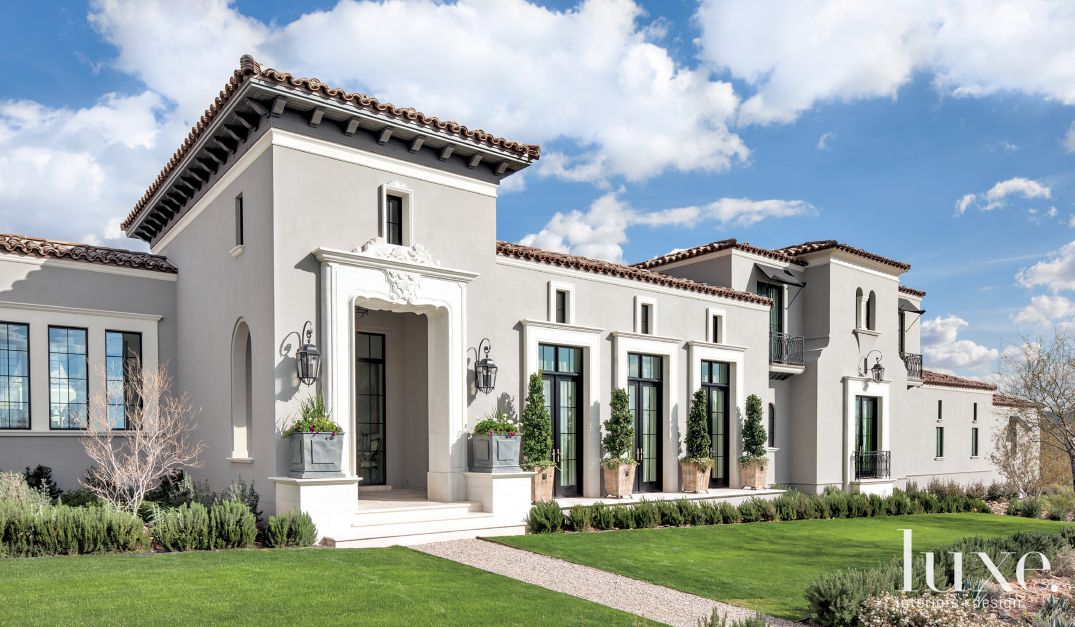Mediterranean gray front exterior luxe interiors design for Stucco facade