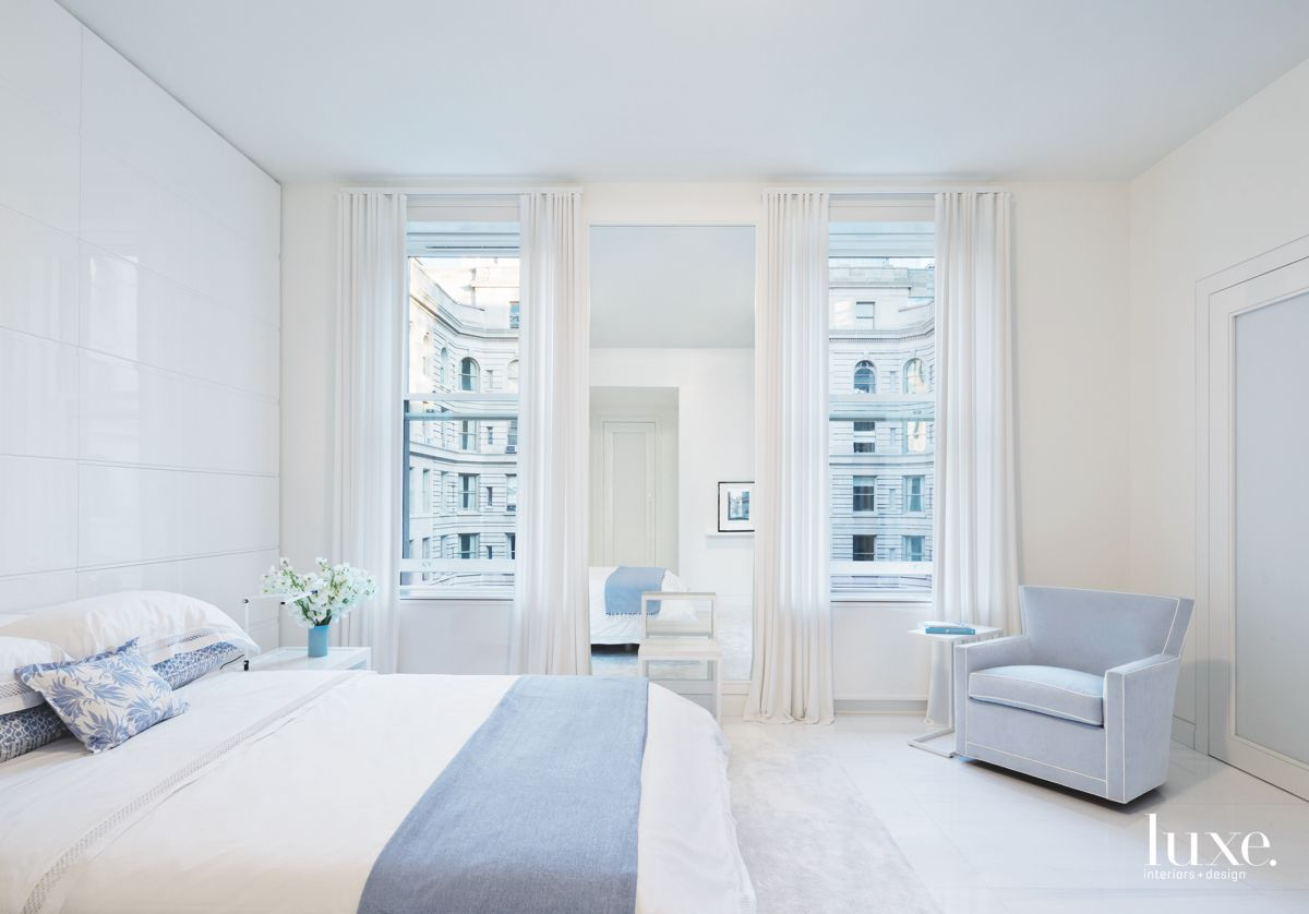 Courtyard View Master Bedroom with Blue Hue Touches