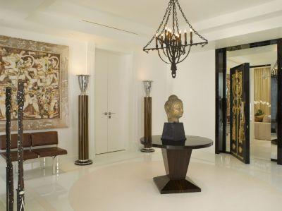 Foyer Interior Urn : Modern neutral foyer with buddha head statue luxe interiors design