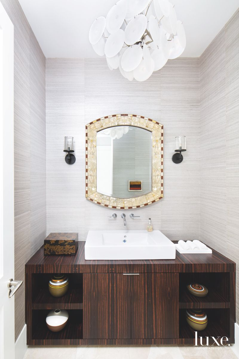 Superb Silver Powder Room with Chandelier and Dark Cabinets