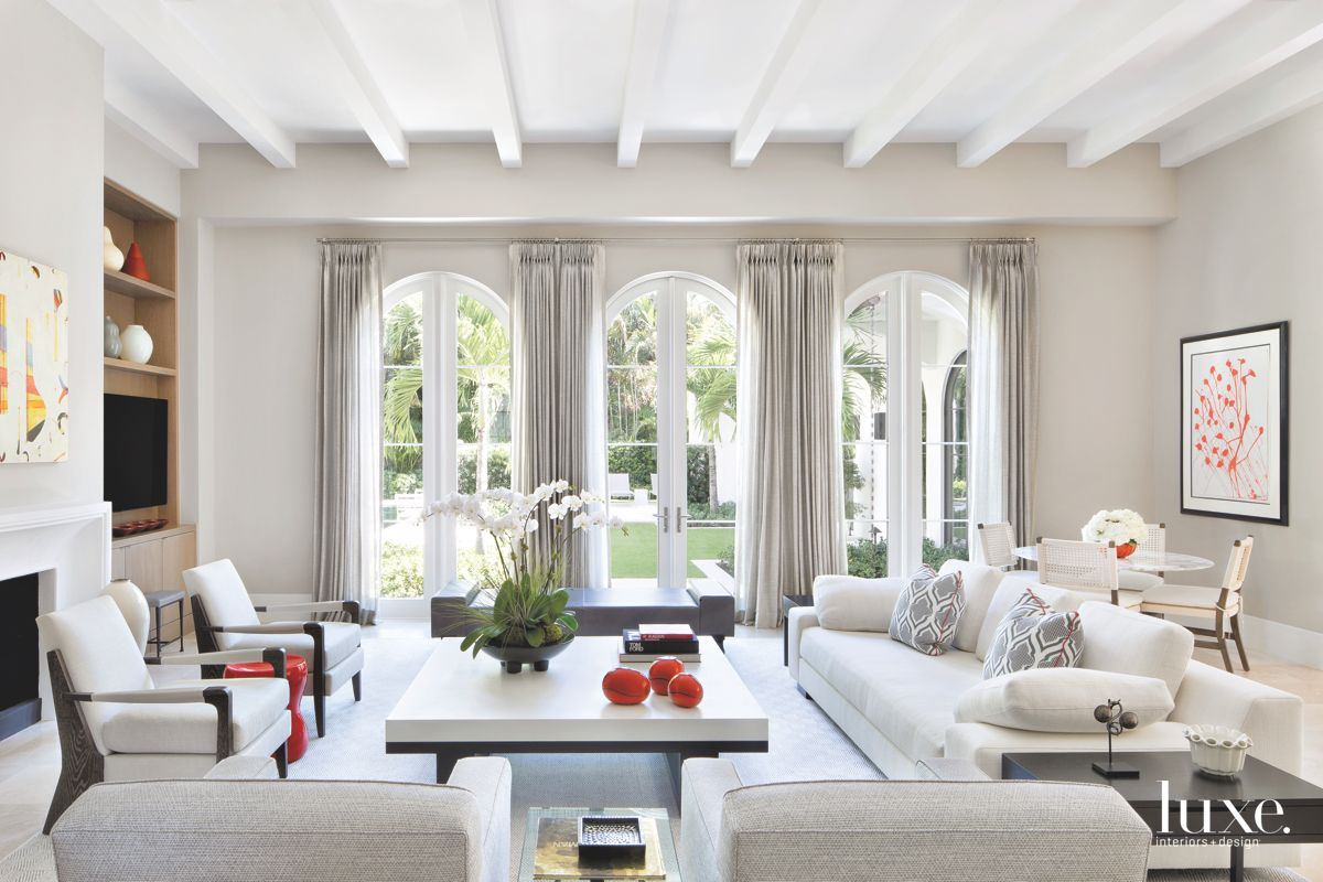 Large Arched Windows with Pops of Red in the Living Room