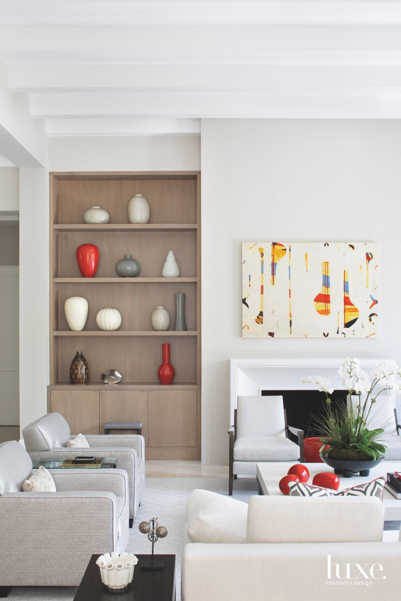 Art and Custom Shelving Feature in Gray Living Room