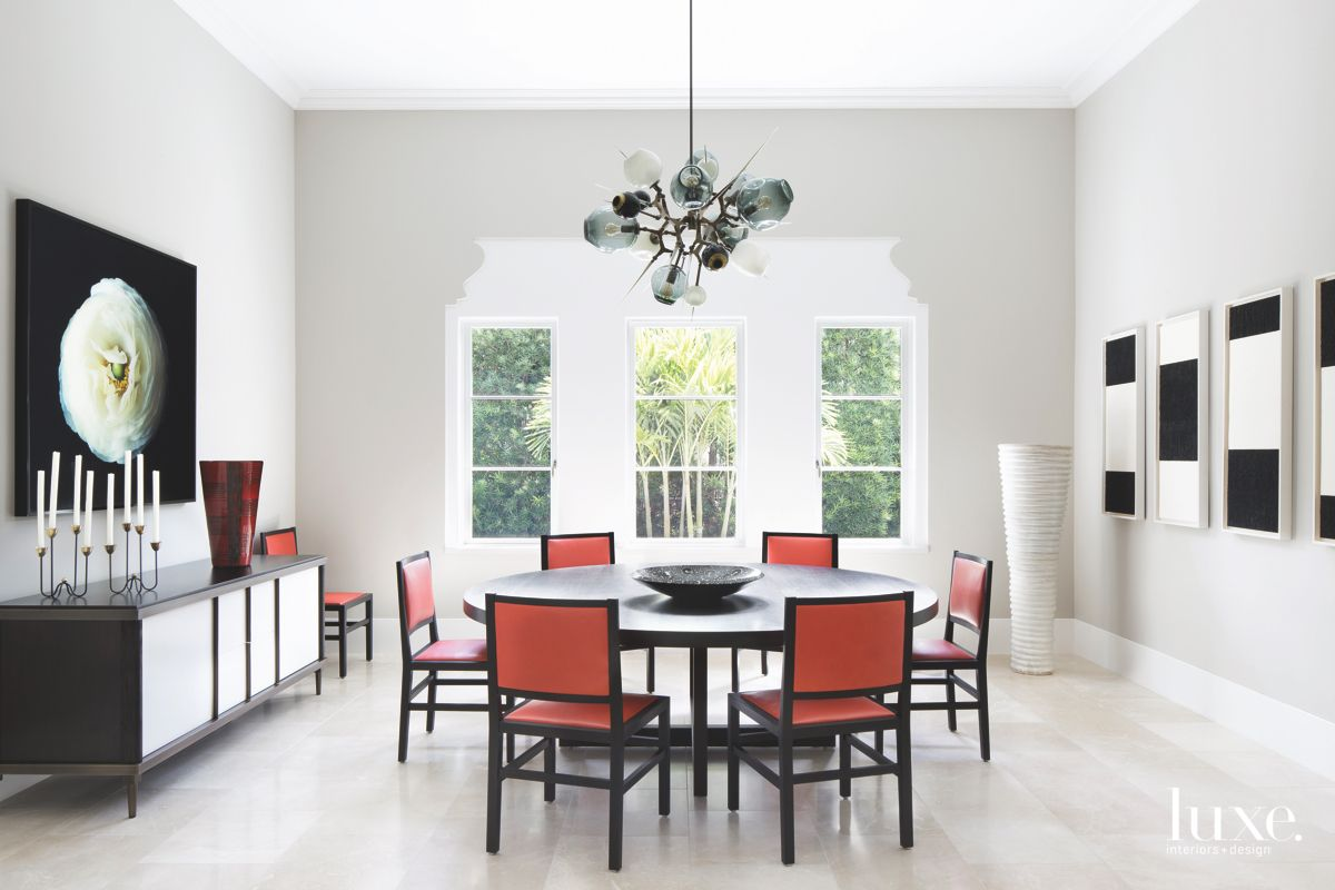 Dining Room Filled with Incredible Art and Red Chairs