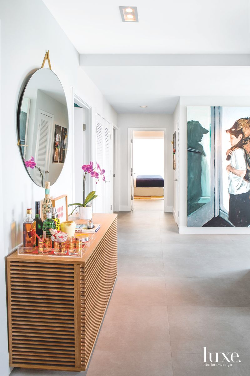 Commanding Statement Entryway with Mirror and Art