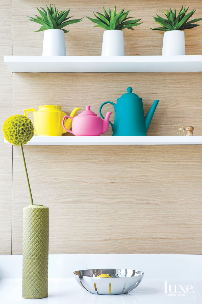 Grouping of Teapots on Wooden Shelves with Flower