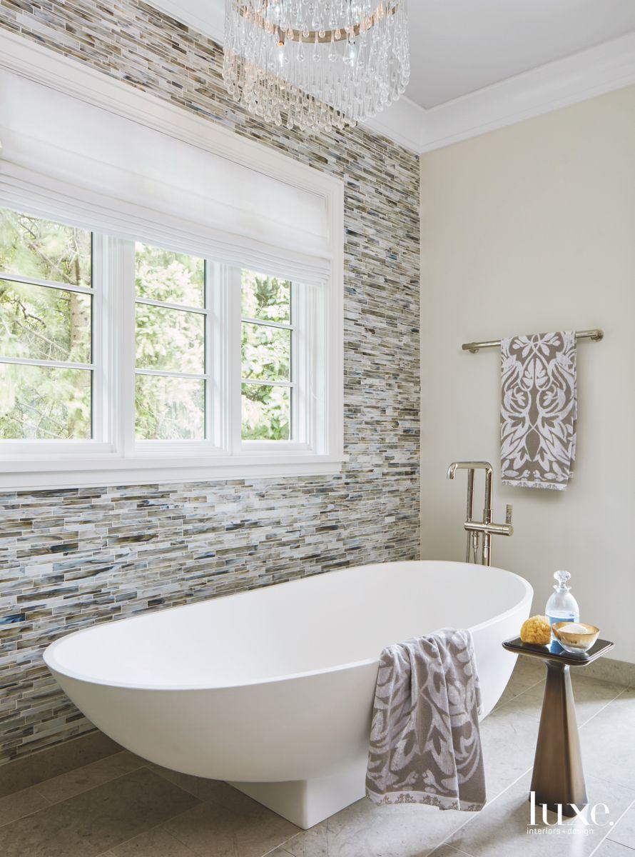 Large Soaking Tub Master Bathroom with Black and White Tile Backsplash