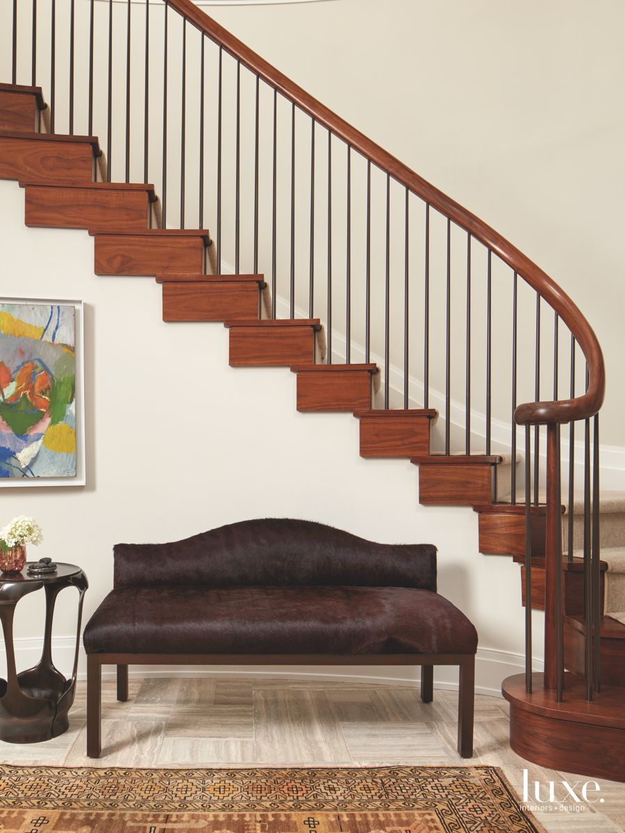Entry Bench in Front of Wooden Staircase with Artwork