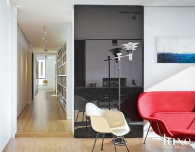 Modern white media room with eames chair luxe interiors design