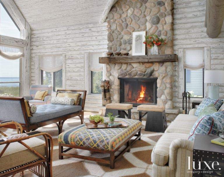 Country White Great Room With Stacked Stone Fireplace Luxe