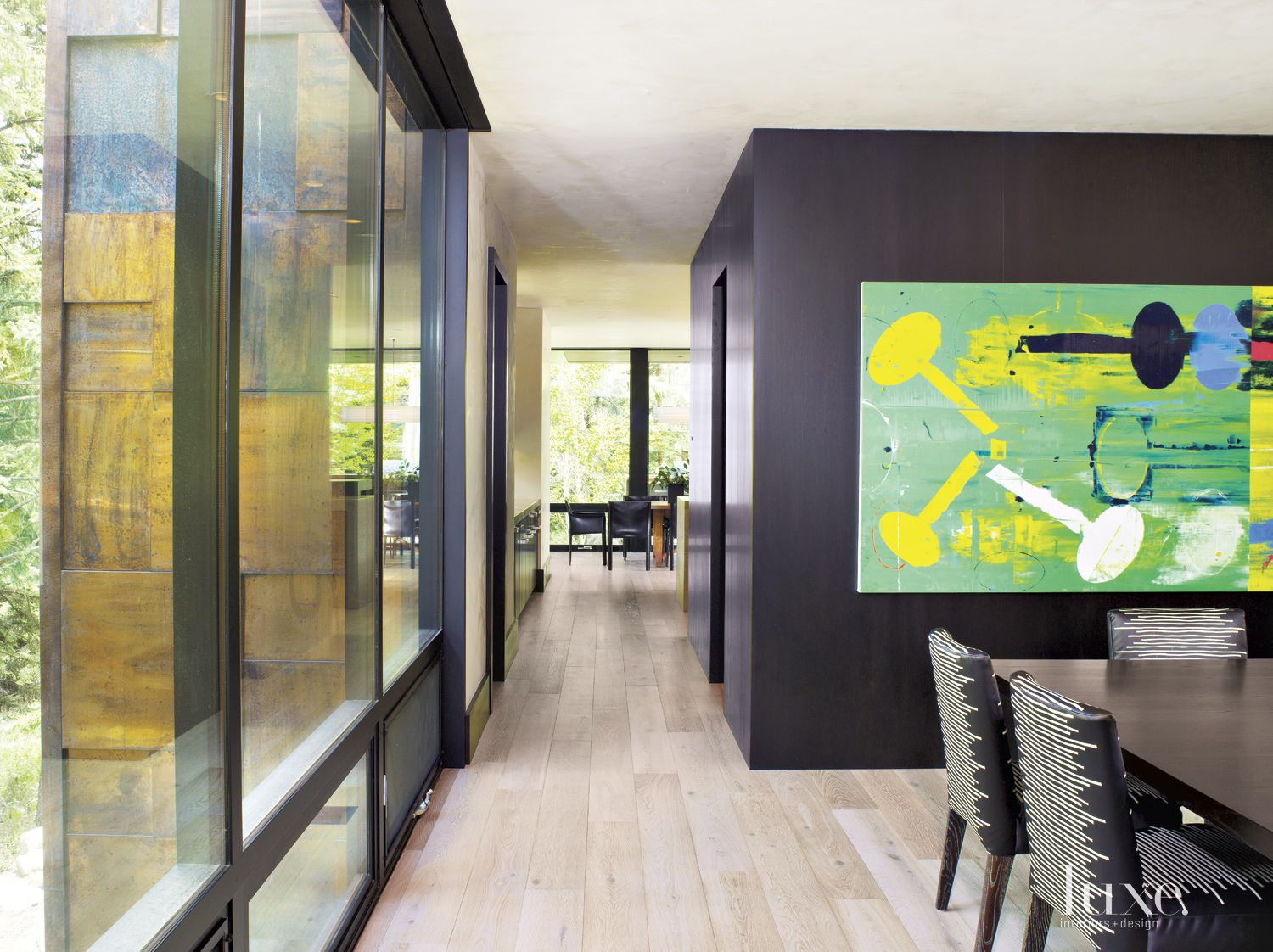 Contemporary Black Dining Room with Green Painting