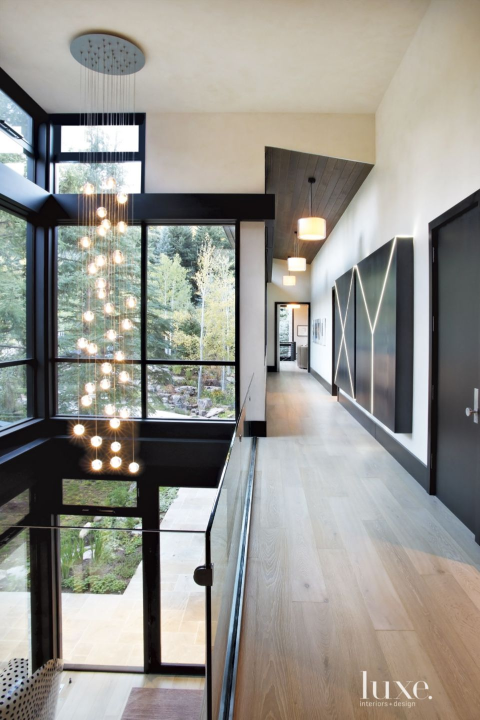 Contemporary Neutral Upper Level with Light Fixture