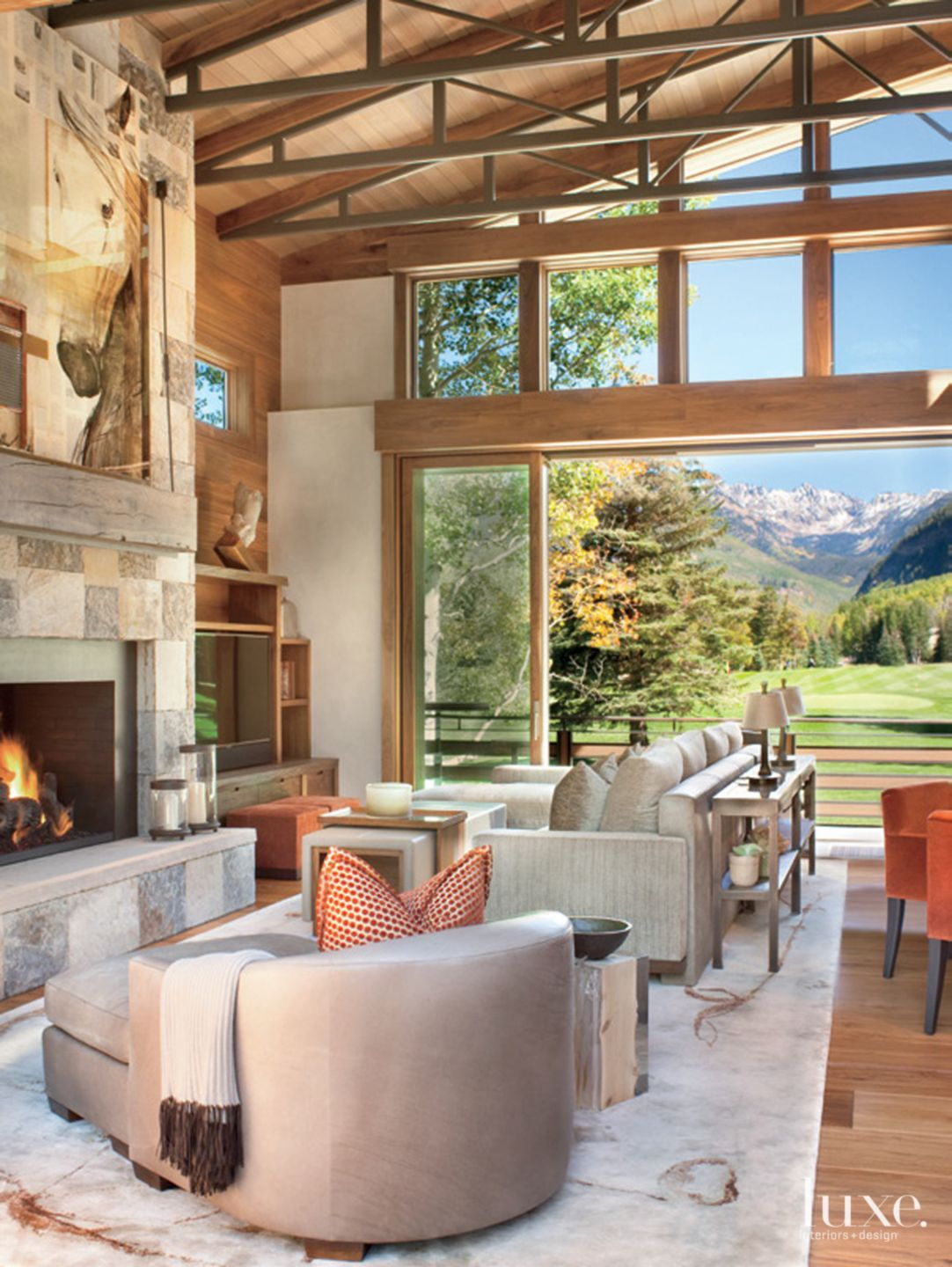 Neutral Mountain Living Room with Stacking Glass Doors