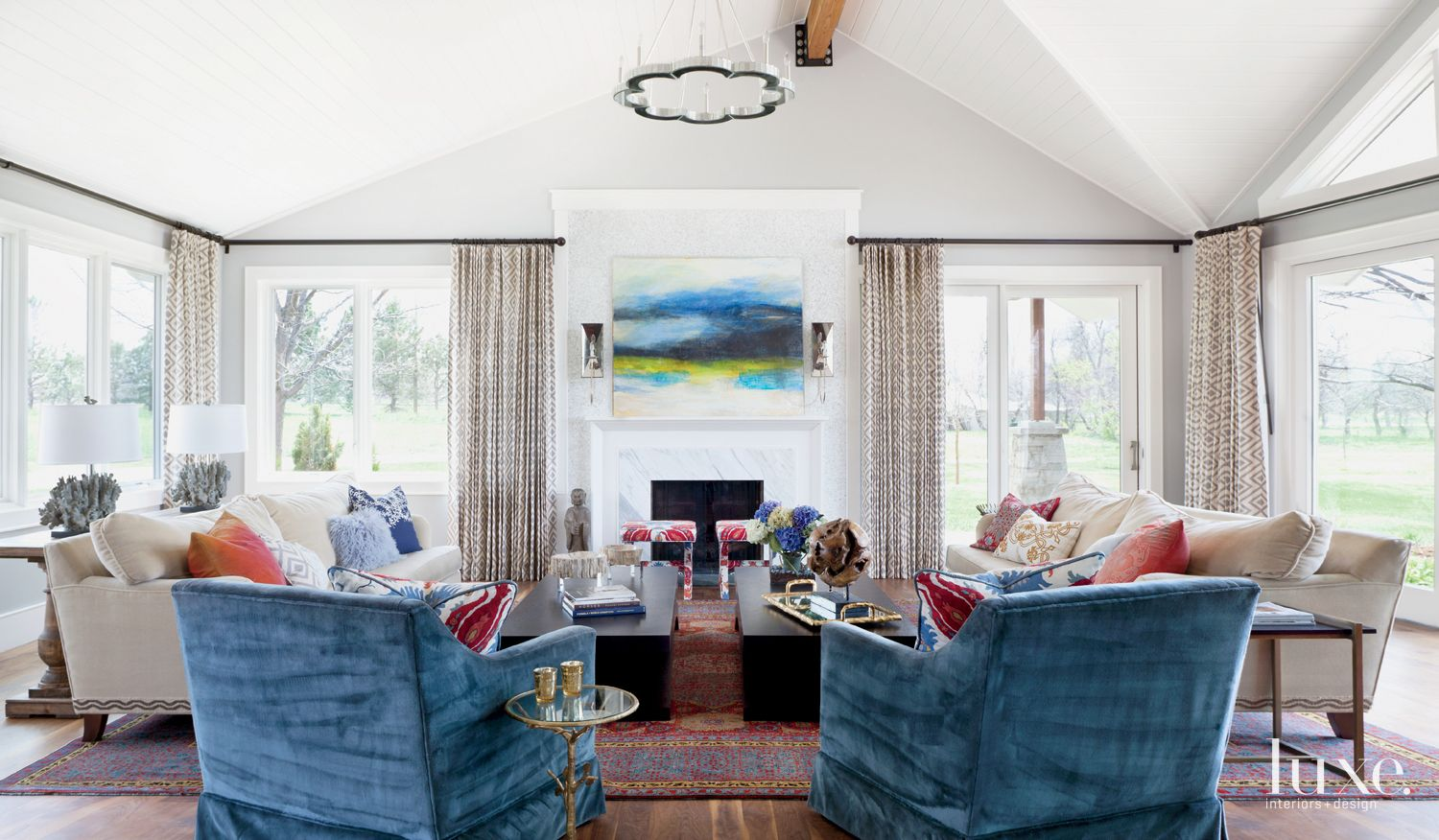 Eclectic White Family Room with Red and Blue Accents