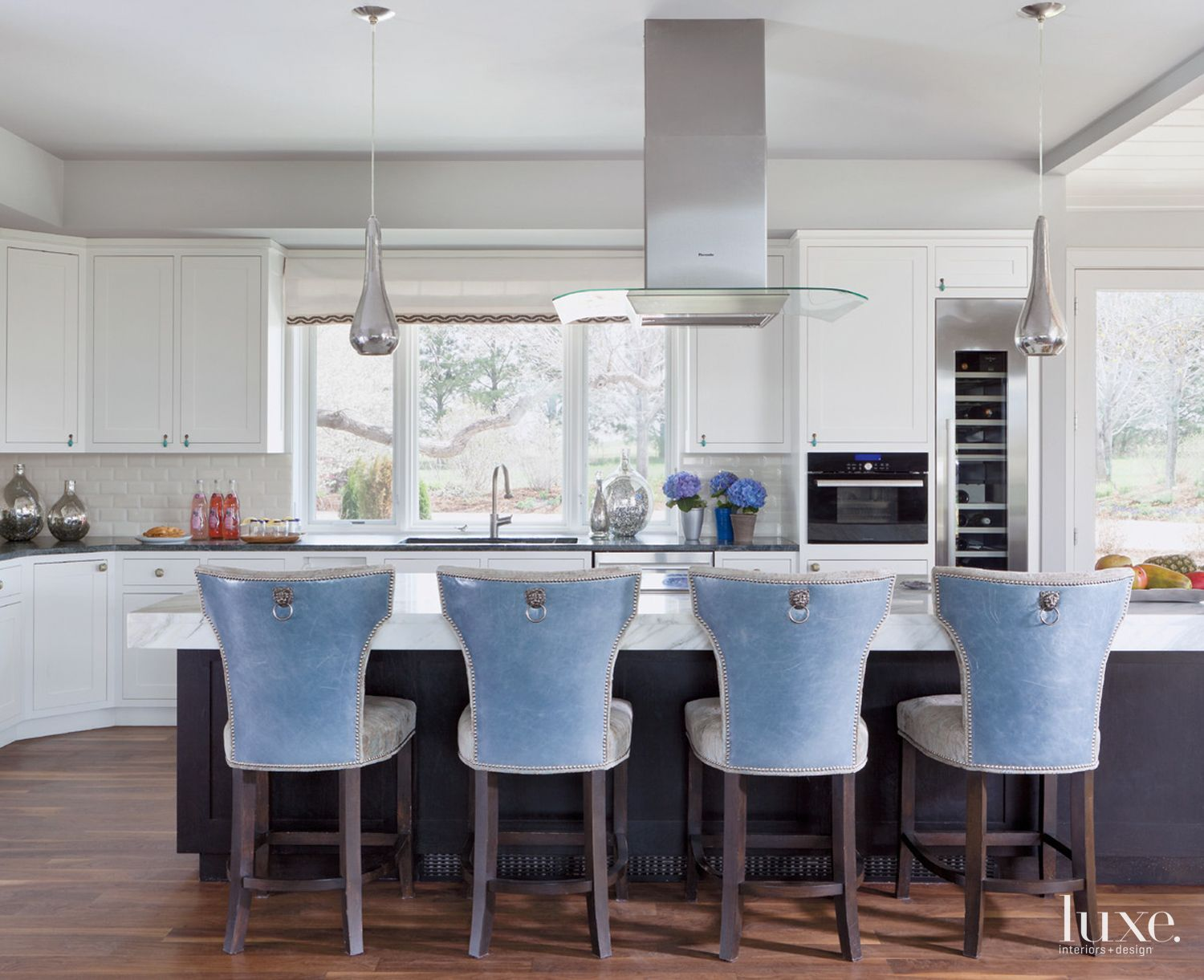 Eclectic White Kitchen with Mercury Glass Pendants