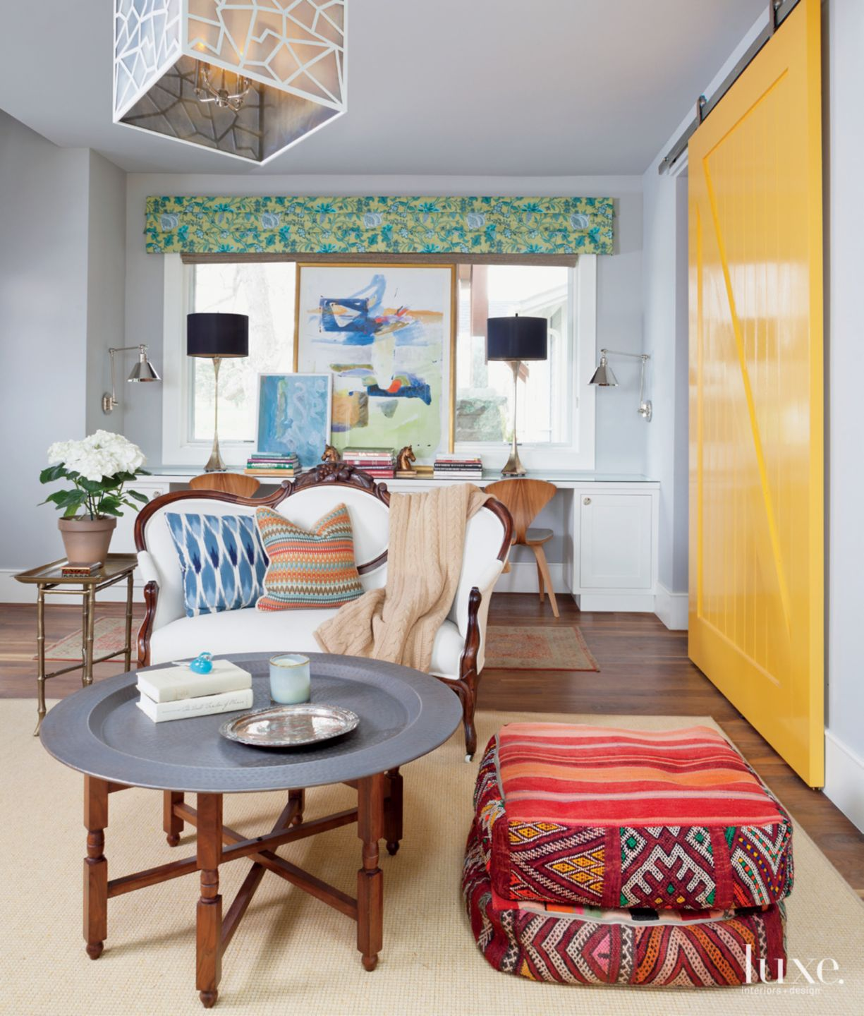 Eclectic Gray Sitting Room with Yellow Barn Door