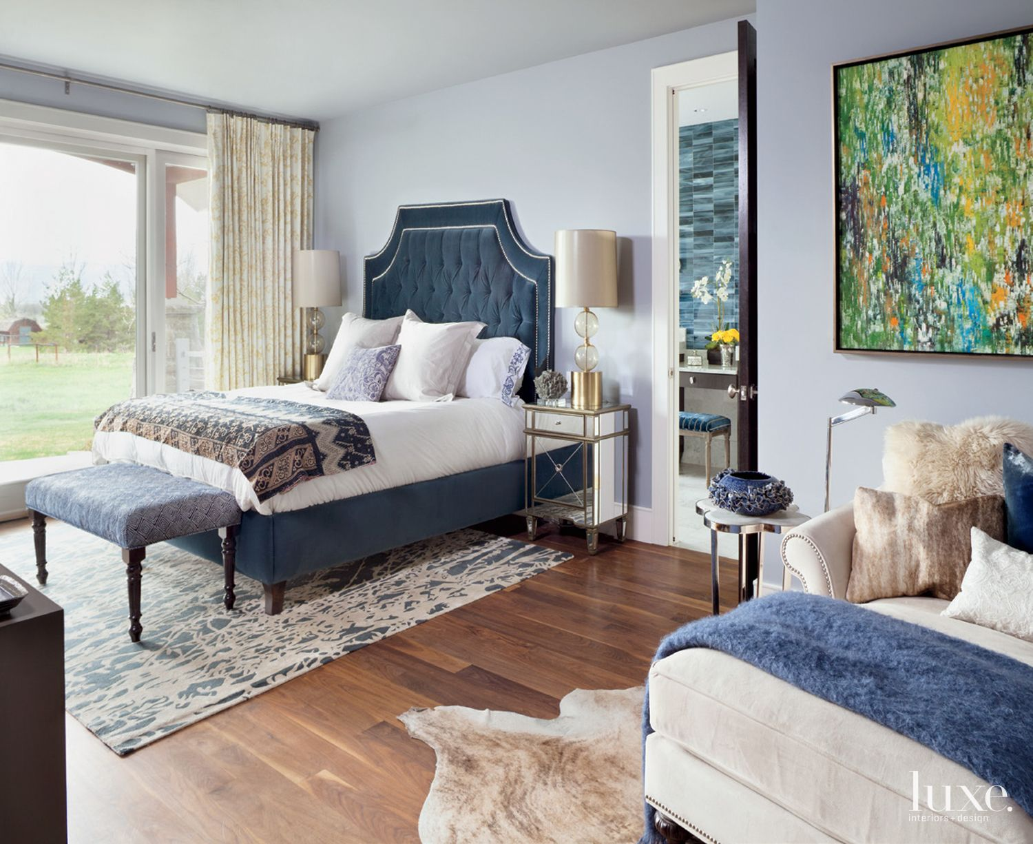 Eclectic Pale Blue Bedroom with Mountain Views