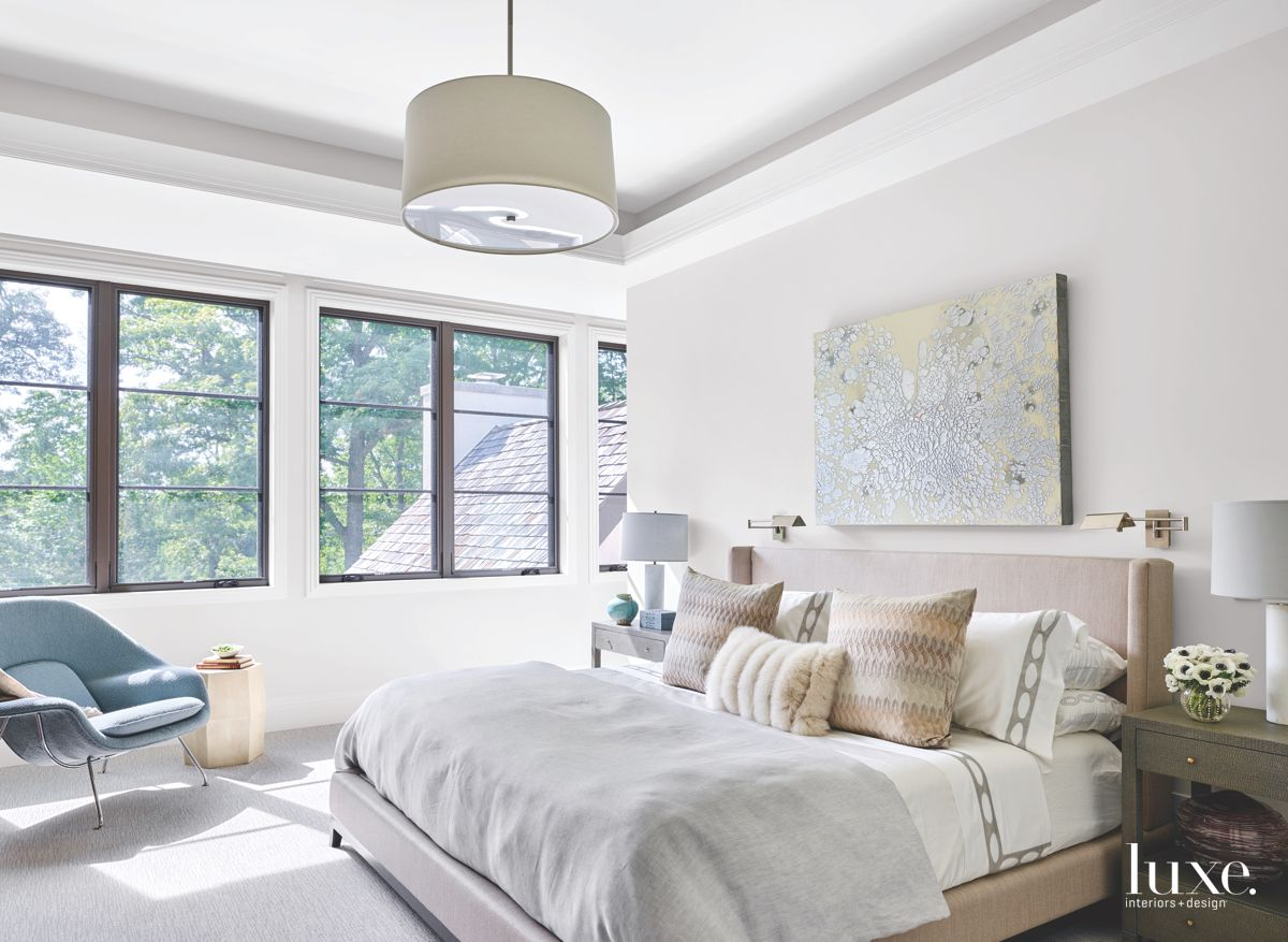 Mostly White Master Bedroom with Iconic Chair and Lamp
