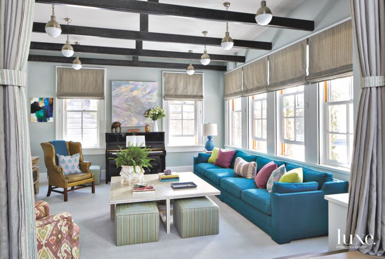 Blue Sofa, Wing Chair, and Ottoman Living Room with Beam Ceiling ...