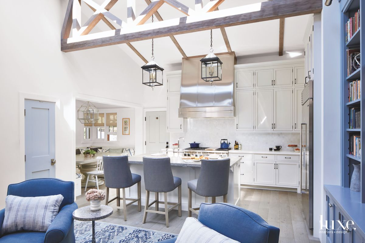 Vaulted Ceiling Wood Beam Kitchen with Lantern Lighting and Blue Accents
