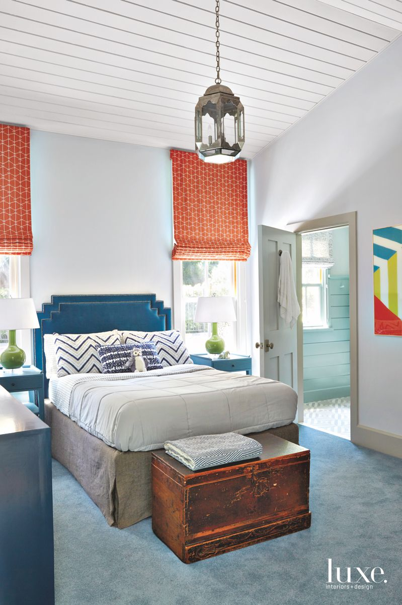 Orange and Blue Bedroom Scheme with Chandelier