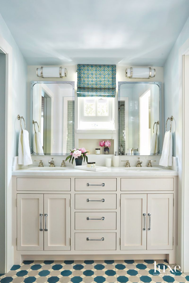 Taupe Bathroom Vanity with Patterned Tile Floors