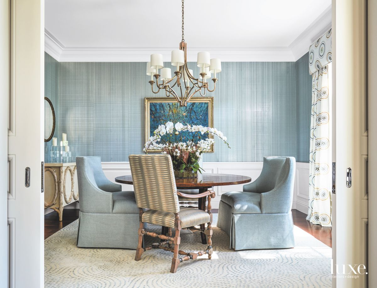 Blue Striped and White Formal Dining Room with Artwork and Chandelier