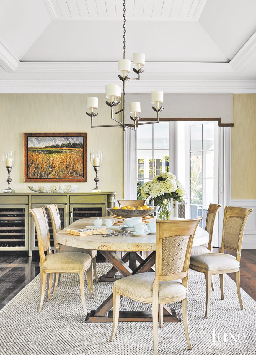 Casual Dining Area with Yellow and Green Touches and Chandelier
