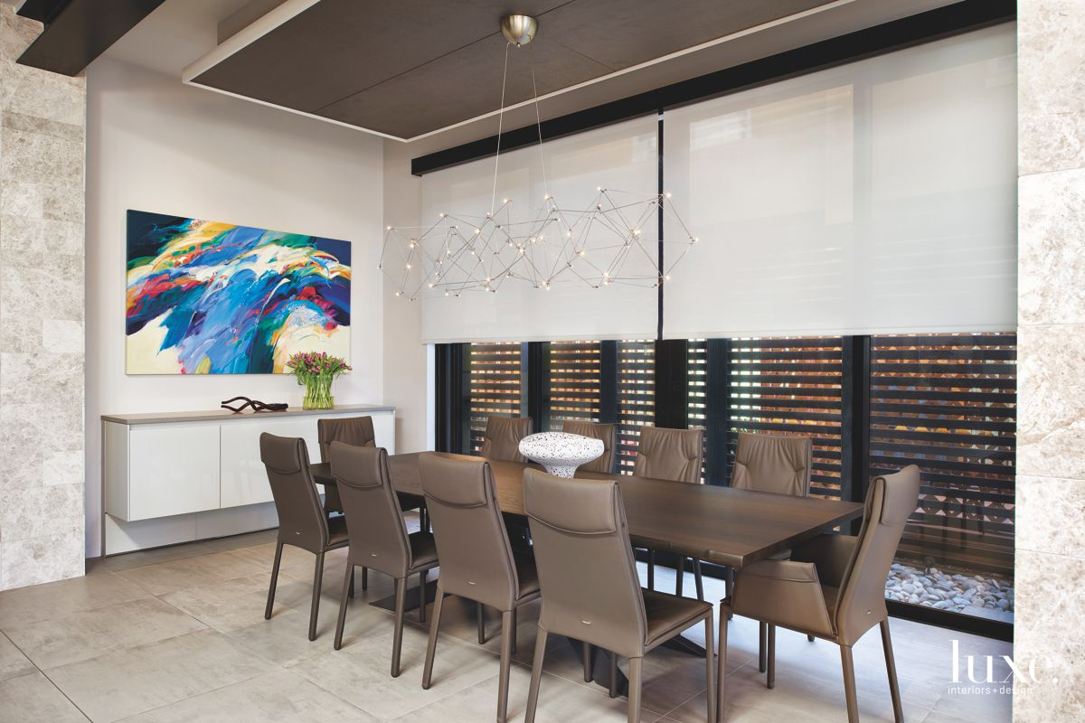 Whimsical Artwork Dining Room with Disguised Wine Rack