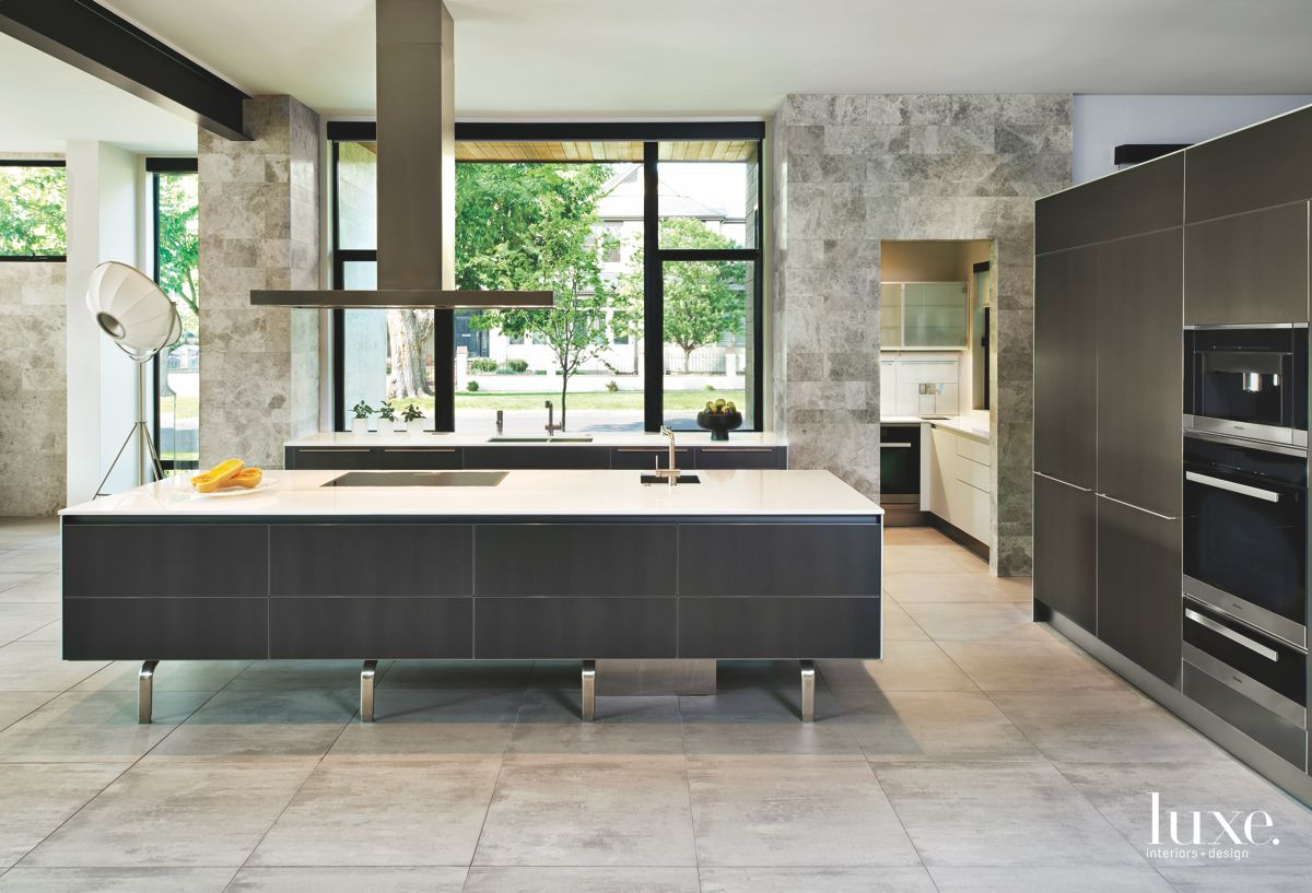 Sleek Angular Kitchen with Hood Range Island
