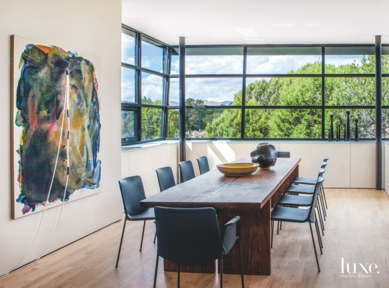 Corner Window Dining Room With Abstract Art And View