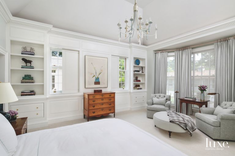 High Square Ceiling All White Master Bedroom With Artwork Chest And