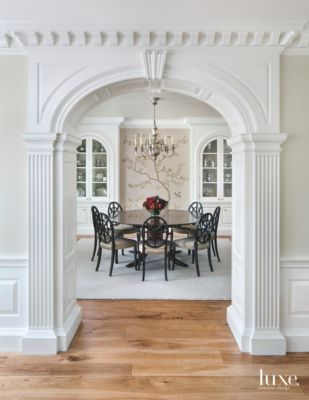 Traditional White Ornate Arch Entrance To Formal Dining Room
