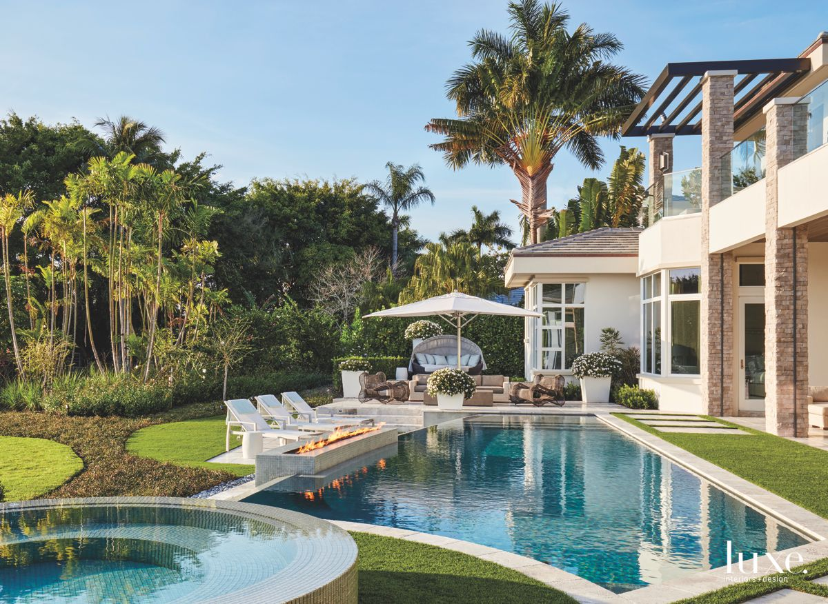 Infinity Pool Backyard with Fire Pit and Palm Trees