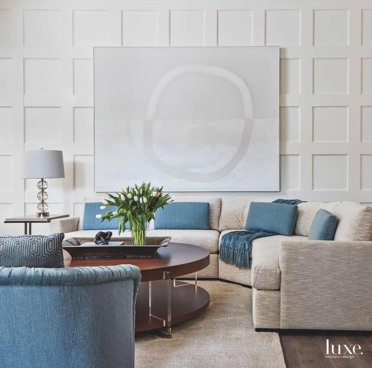 Mixed Media White Family Room Artwork with Blue Accents and Coffered Walls