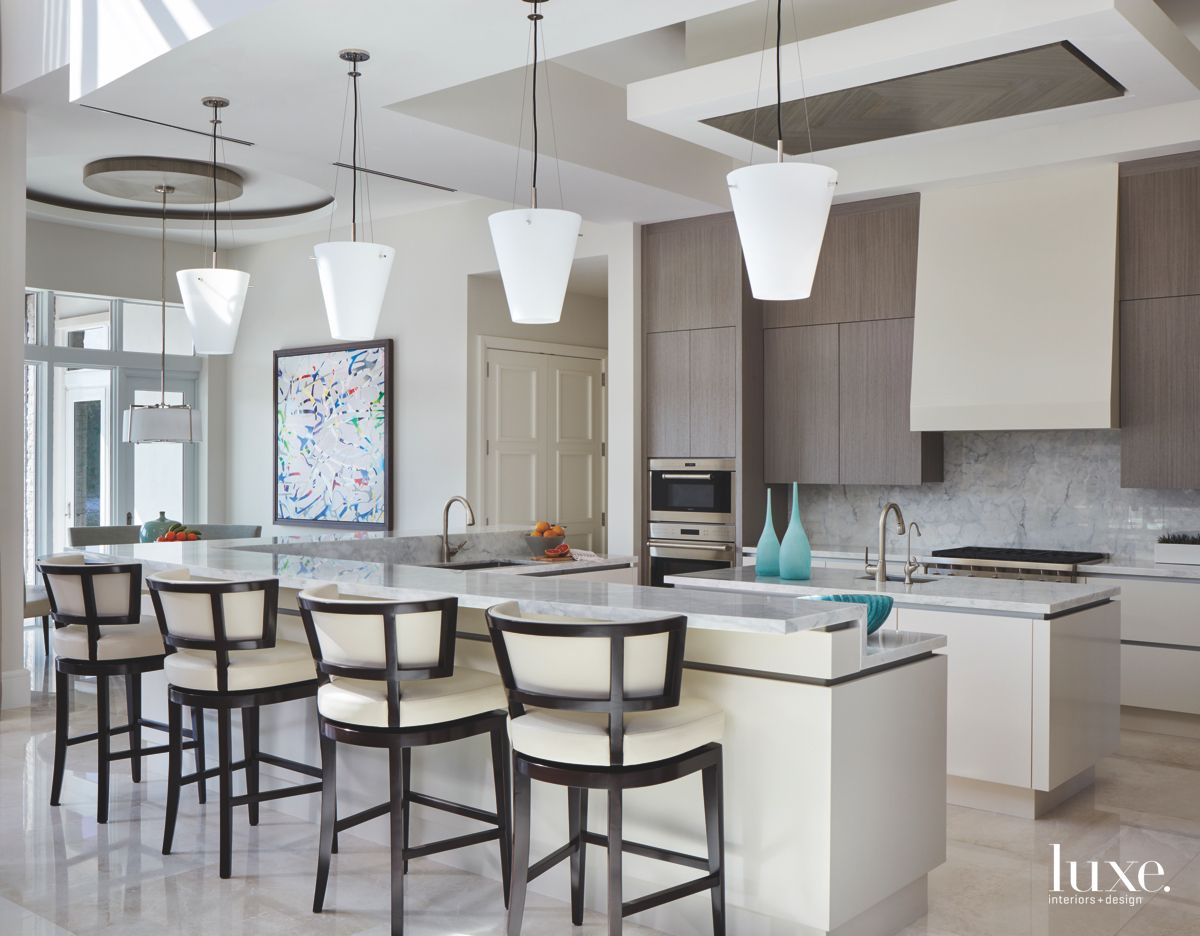 Modern Kitchen with Cone Light Pendants and Brown Accents