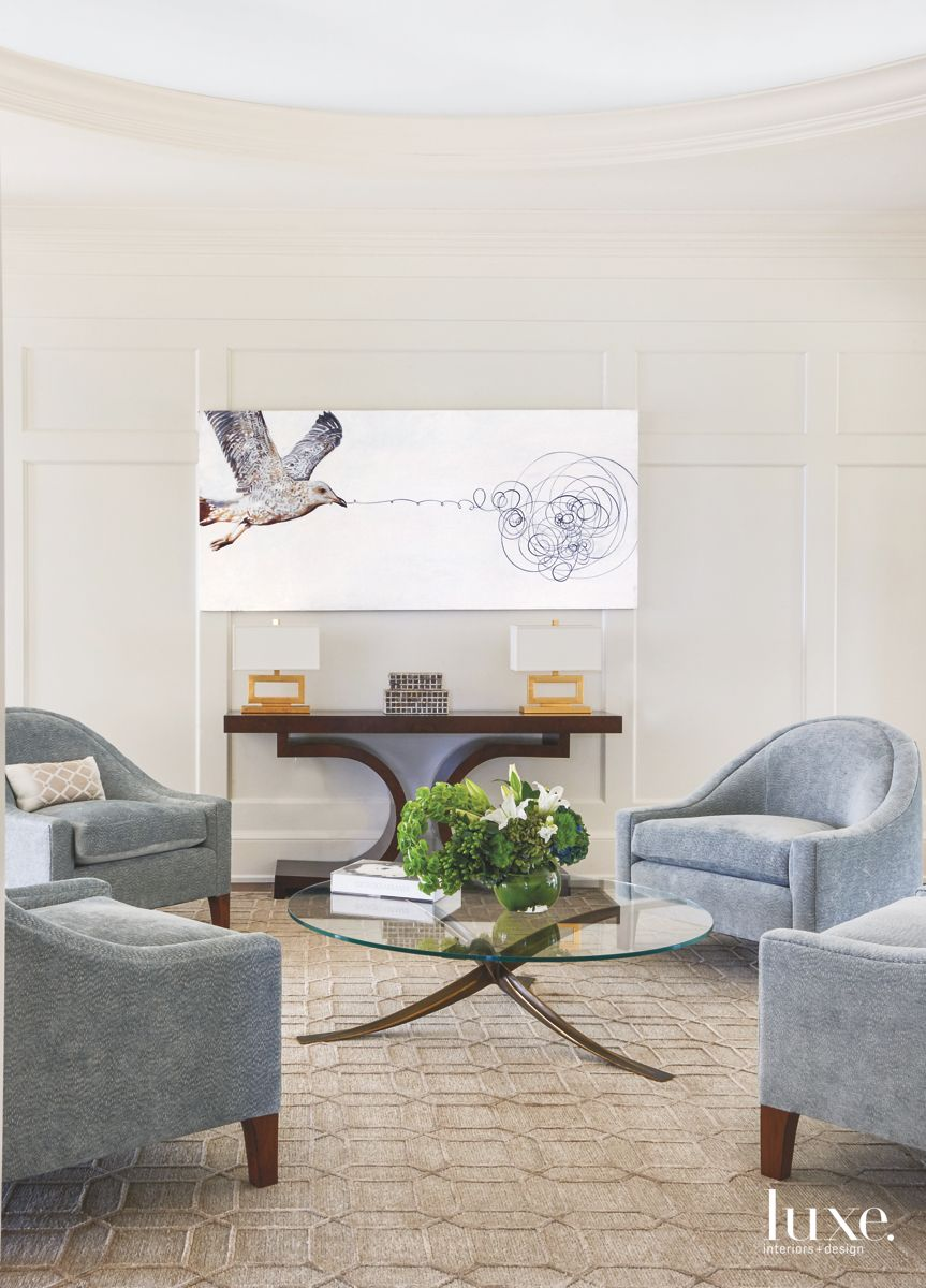 Intimate Sitting Area with Playful Bird Artwork