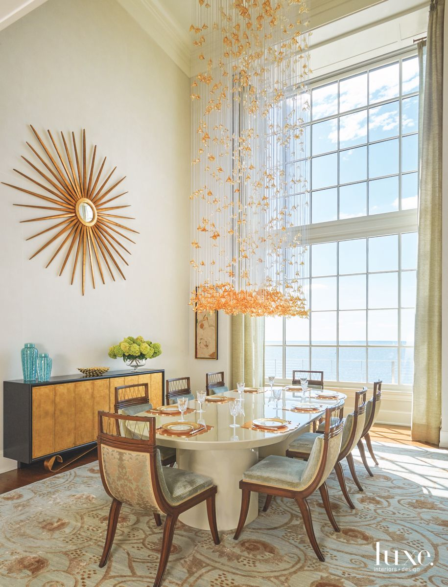 Dining Room with a Dramatic Ocean View and Cascading Chandelier