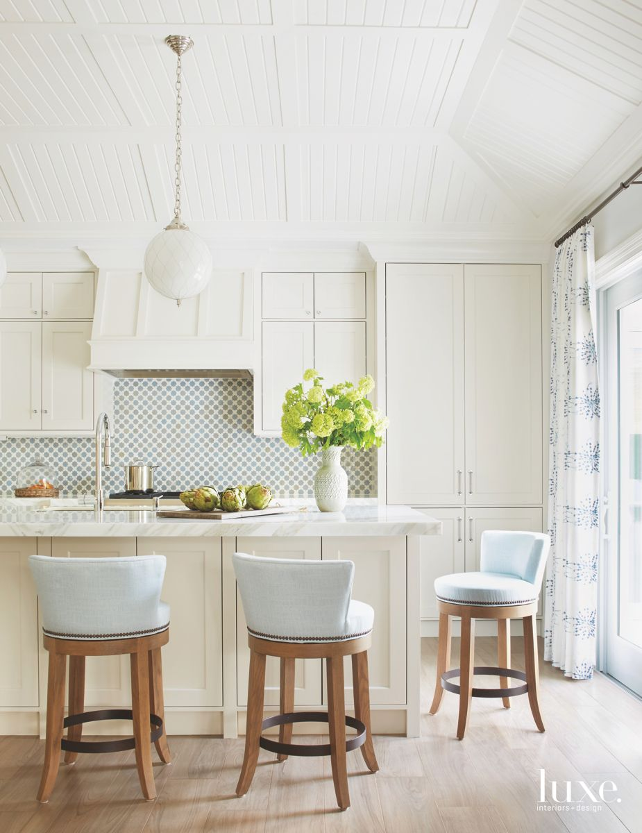 Tongue and Groove White Kitchen with Pale Baby Blue Stools