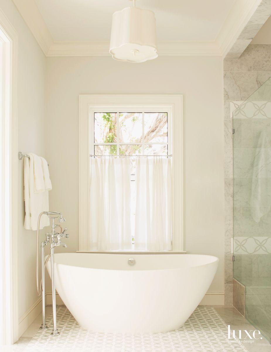 Freestanding Sculptural Tub Master Bathroom with Adjacent Shower and Patterned Tile