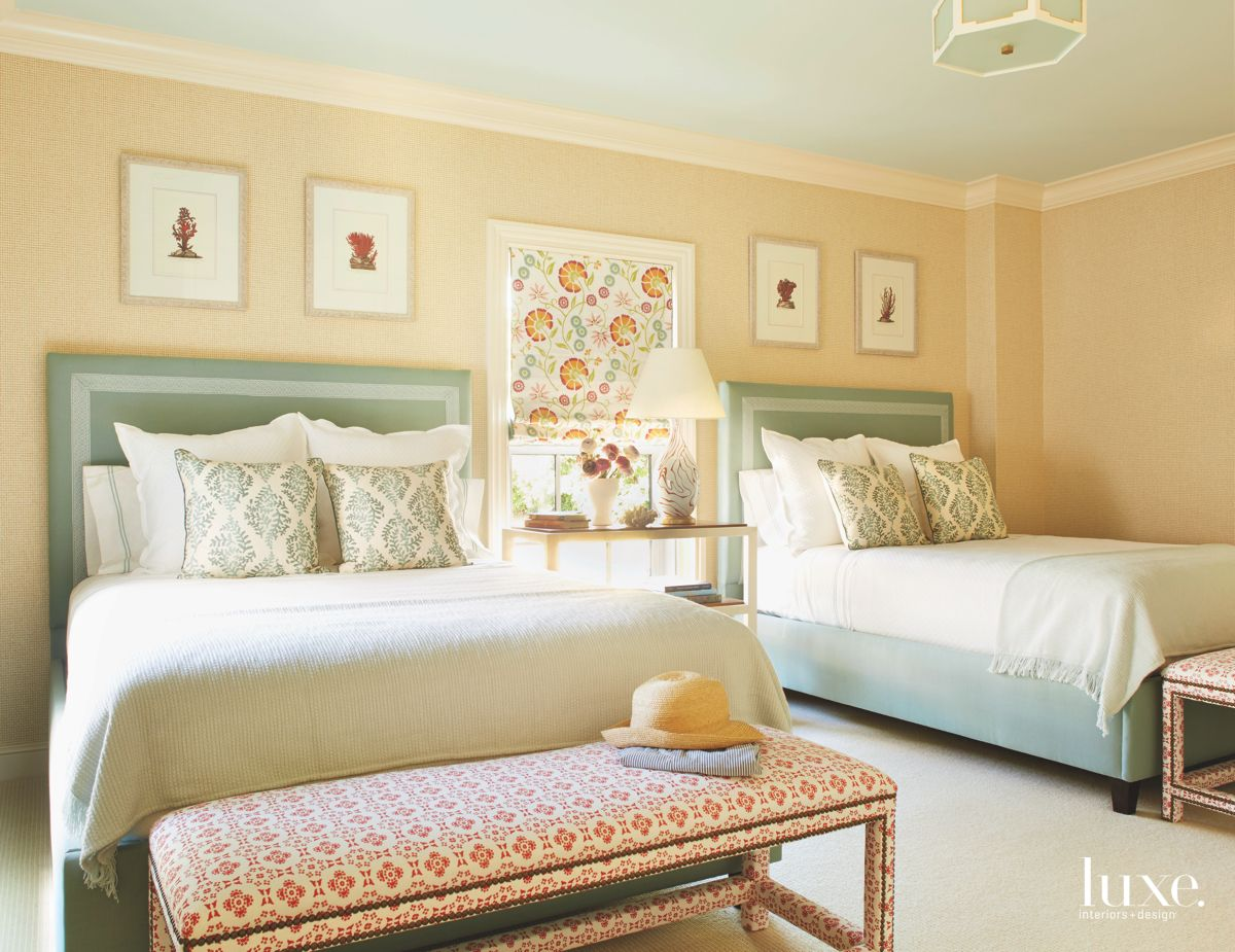 Citrus and Green Floral Guest Bedroom with Hanging Artwork and Nightstand