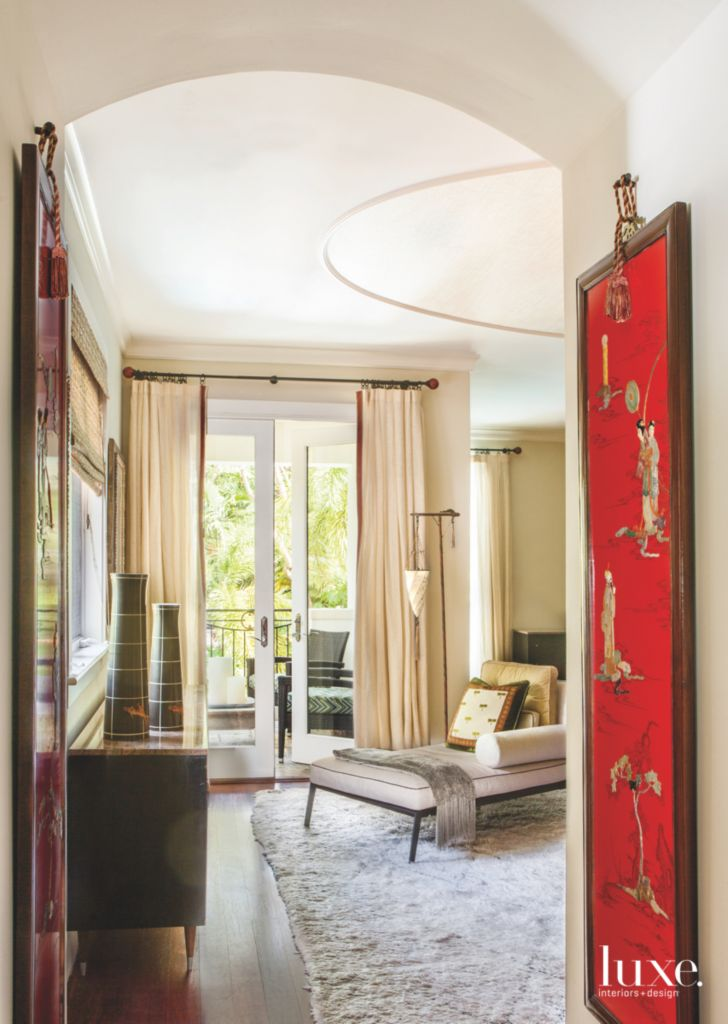 Red Asian Art Master Bedroom Entrance With Neutral Chaise Luxe