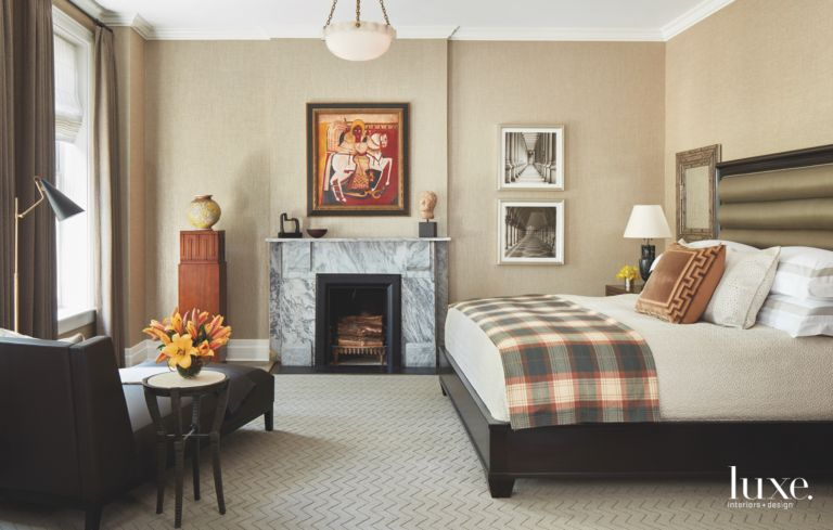 Neutral Master Bedroom Color Scheme with Black Fireplace and Artwork ...