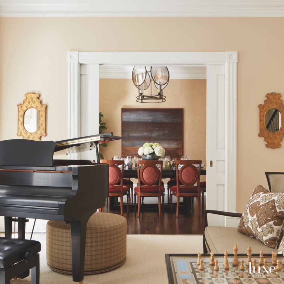 Dining Room View Piano Living Room with Red Chairs and ...