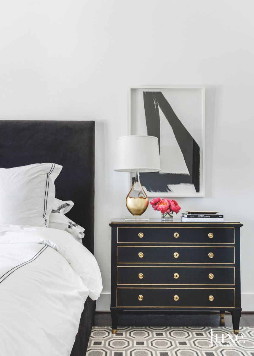 Black Bedroom Nightstand Chest with Lamp and Artwork