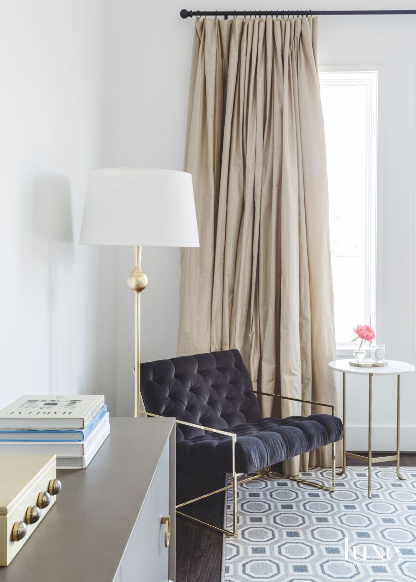 Master Bedroom Corner with Black Lounge Chair and Lamp
