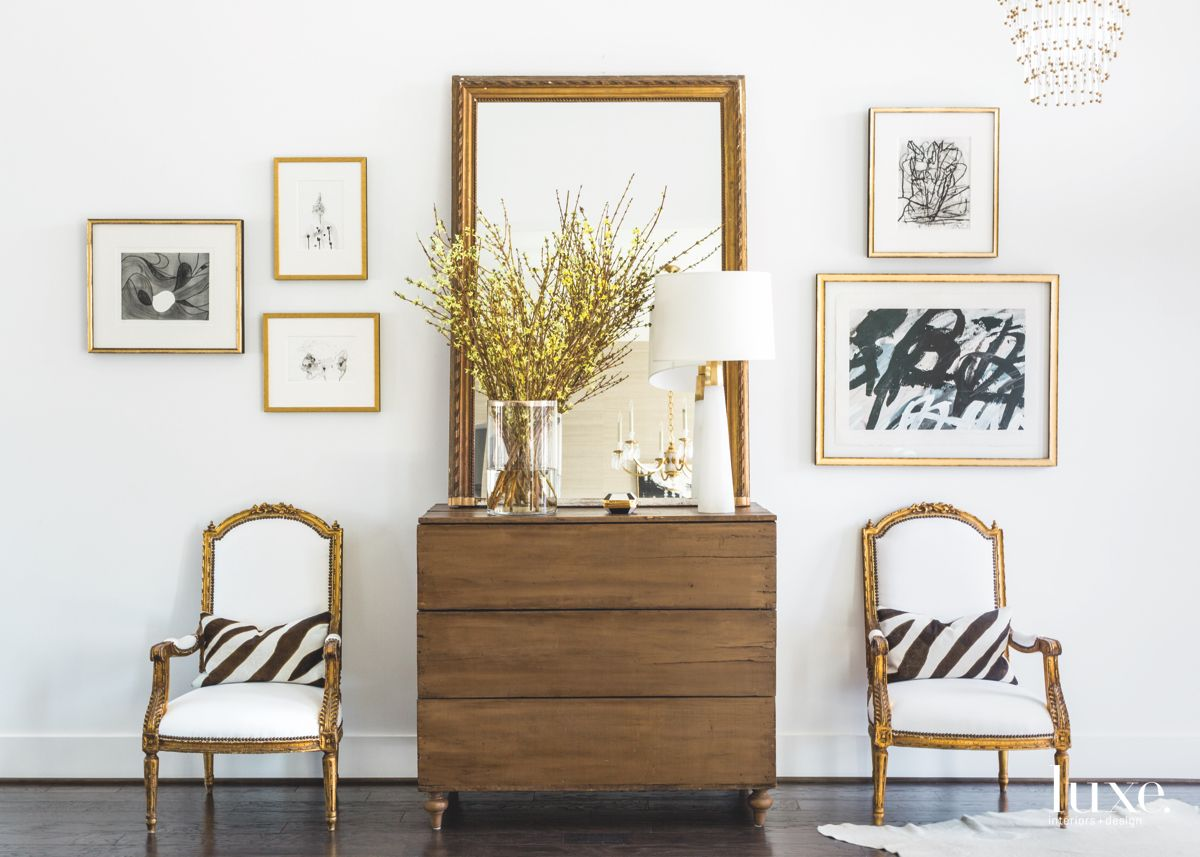 Artful Zebra Entry Foyer with Flowers and Mirror