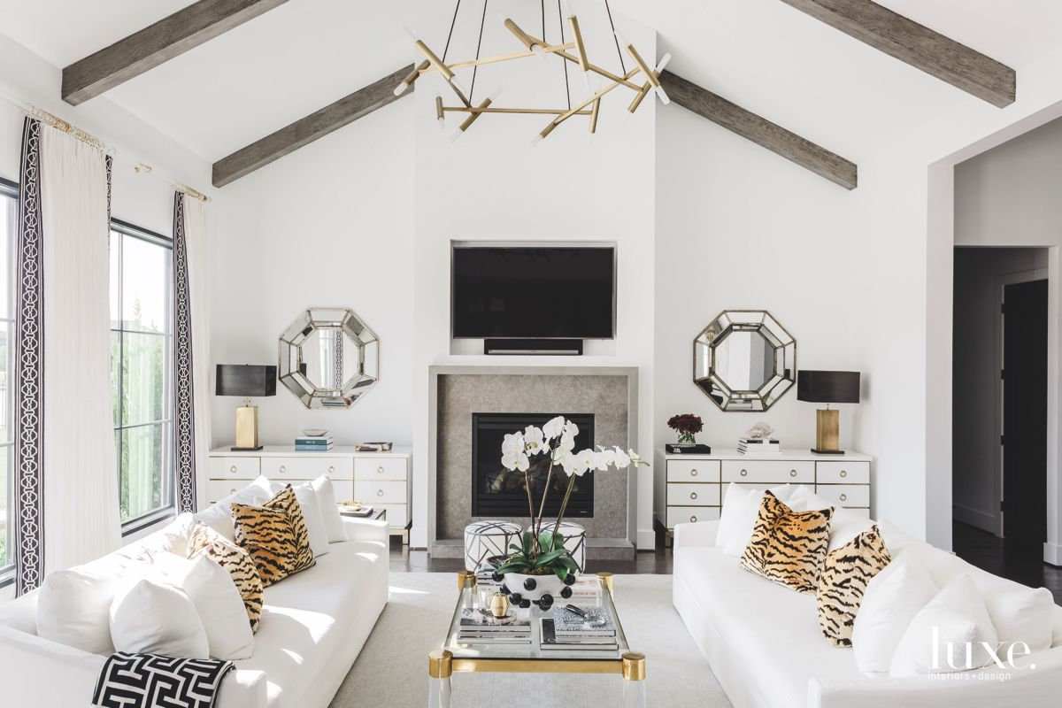 Cheetah Animal Print Pillow Living Room with Television and Chandeliers